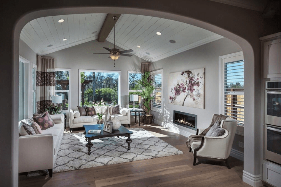 The floral accents in this living room at Crowne Point in Rocklin, CA are one of our 2018 design trends.